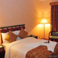 Отель Holiday International Sharjah ОАЭ, Шарджа - 5 отзывов об отеле, цены и фото номеров - забронировать отель Holiday International Sharjah онлайн комната для гостей фото 2