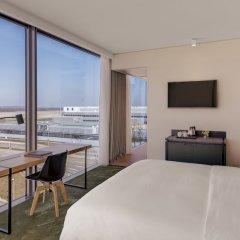 Отель Hilton Munich Airport Германия, Мюнхен - 7 отзывов об отеле, цены и фото номеров - забронировать отель Hilton Munich Airport онлайн пляж