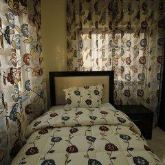 Отель Aqarco Shmaisani Apartment Иордания, Амман - отзывы, цены и фото номеров - забронировать отель Aqarco Shmaisani Apartment онлайн комната для гостей фото 5