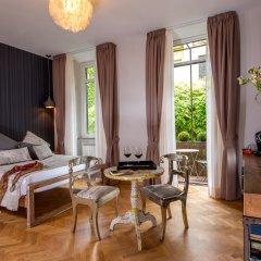 Апартаменты QT Suites & Apartments - Sistina комната для гостей фото 4