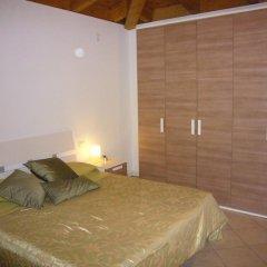 Отель Montecolo Resort Манерба-дель-Гарда комната для гостей фото 4