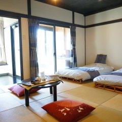 Отель Ryokan Nagomitsuki Япония, Беппу - отзывы, цены и фото номеров - забронировать отель Ryokan Nagomitsuki онлайн комната для гостей фото 3