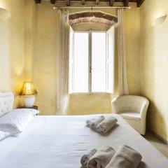 Апартаменты Piccolo Signoria Apartment Флоренция комната для гостей фото 3