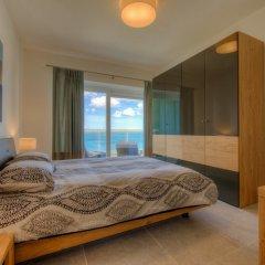 Отель Seafront Luxury APT With Pool Мальта, Слима - отзывы, цены и фото номеров - забронировать отель Seafront Luxury APT With Pool онлайн комната для гостей фото 3