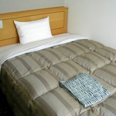 Отель Route-Inn Oita Ekimae Ойта комната для гостей
