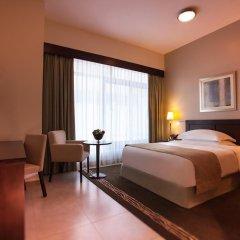 Апартаменты Movenpick Apartment Bur Dubai комната для гостей фото 3