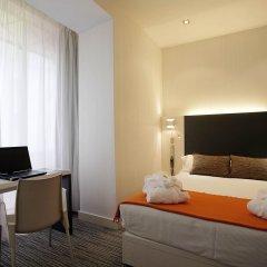 Отель Petit Palace Sevilla Canalejas Испания, Севилья - отзывы, цены и фото номеров - забронировать отель Petit Palace Sevilla Canalejas онлайн удобства в номере