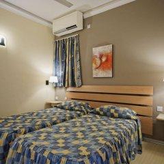 Отель Porto Azzurro Aparthotel комната для гостей фото 5