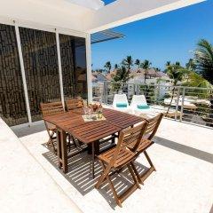 Отель Ducassi Suites Rooftop Pool Beach Club & Spa балкон