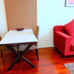 Апартаменты GM Serviced Apartment Бангкок комната для гостей фото 3