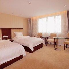 Отель Jinxing Holiday Hotel - Zhongshan Китай, Чжуншань - отзывы, цены и фото номеров - забронировать отель Jinxing Holiday Hotel - Zhongshan онлайн комната для гостей фото 5