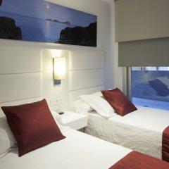 Апартаменты AxelBeach Ibiza Suites Apartments Spa and Beach Club - Adults Only комната для гостей