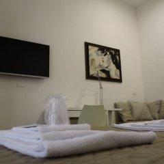 Отель Attico Luxury B&B Капуя сейф в номере