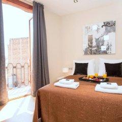 Апартаменты Plaza España Apartments Барселона комната для гостей фото 5