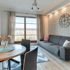 Апартаменты Downtown Apartments - Nowa Motlawa комната для гостей фото 6