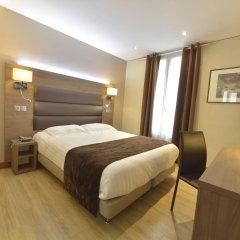 Отель Unic Renoir Saint Germain Париж комната для гостей