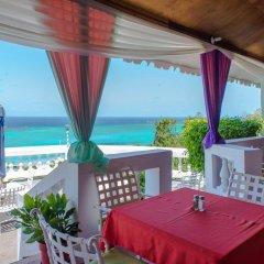 Отель Skymiles Beach Suite At Montego Bay Club Resort Ямайка, Монтего-Бей - отзывы, цены и фото номеров - забронировать отель Skymiles Beach Suite At Montego Bay Club Resort онлайн балкон