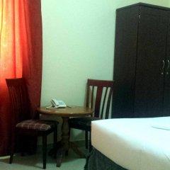 Отель Al Reem Hotel Apartments ОАЭ, Шарджа - отзывы, цены и фото номеров - забронировать отель Al Reem Hotel Apartments онлайн удобства в номере фото 2