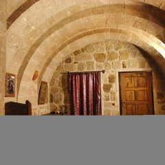 Cappadocia Ihlara Mansions & Caves Турция, Гюзельюрт - отзывы, цены и фото номеров - забронировать отель Cappadocia Ihlara Mansions & Caves онлайн интерьер отеля фото 2