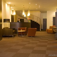 Отель NH Amsterdam Caransa интерьер отеля