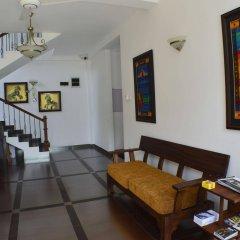 Отель Villa Baywatch Rumassala Шри-Ланка, Унаватуна - отзывы, цены и фото номеров - забронировать отель Villa Baywatch Rumassala онлайн интерьер отеля