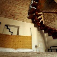 Отель Trulli Pietradimora B&B Альберобелло сейф в номере