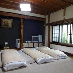Отель Hakuba Ski Kan Хакуба сейф в номере