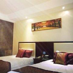 Suzhou Pinzhen Fudi Hotel комната для гостей