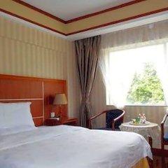 China's Emerging Business Hotel комната для гостей