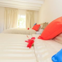 Отель Sunset Shores Beach Hotel Сент-Винсент и Гренадины, Остров Бекия - отзывы, цены и фото номеров - забронировать отель Sunset Shores Beach Hotel онлайн комната для гостей фото 5