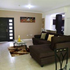 Отель Secure New Kingston Condo Ямайка, Кингстон - отзывы, цены и фото номеров - забронировать отель Secure New Kingston Condo онлайн комната для гостей фото 5