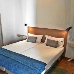 Frenteabastos Hostel & Suites комната для гостей