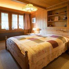 Отель Gstaad - Amazing Lake Chalet комната для гостей