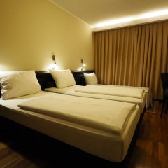 Отель Rivoli Германия, Мюнхен - 7 отзывов об отеле, цены и фото номеров - забронировать отель Rivoli онлайн комната для гостей фото 2