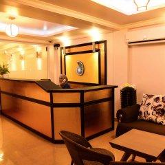 Отель Golden Spiral Maldives Мальдивы, Мале - отзывы, цены и фото номеров - забронировать отель Golden Spiral Maldives онлайн интерьер отеля