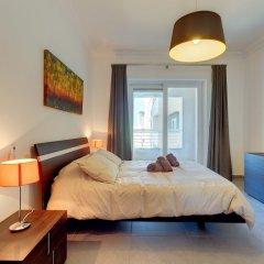 Отель Stunning Seafront Lux Apt, Fort Cambridge wt Pool Мальта, Слима - отзывы, цены и фото номеров - забронировать отель Stunning Seafront Lux Apt, Fort Cambridge wt Pool онлайн комната для гостей