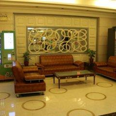 Отель Holiday Apartment Hotel Китай, Шэньчжэнь - отзывы, цены и фото номеров - забронировать отель Holiday Apartment Hotel онлайн интерьер отеля