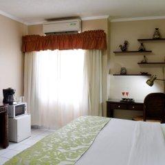 Отель Aparthotel Guijarros Гондурас, Тегусигальпа - отзывы, цены и фото номеров - забронировать отель Aparthotel Guijarros онлайн удобства в номере