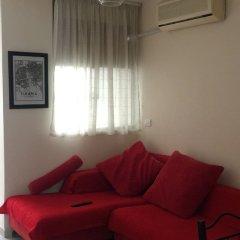 Отель Tirana Apartment Албания, Тирана - отзывы, цены и фото номеров - забронировать отель Tirana Apartment онлайн комната для гостей фото 4