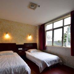 Отель Shanghai Old West Gate Hostel Китай, Шанхай - 1 отзыв об отеле, цены и фото номеров - забронировать отель Shanghai Old West Gate Hostel онлайн комната для гостей фото 3
