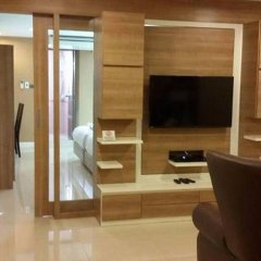 Апартаменты Pintree Service Apartment Pattaya Паттайя комната для гостей