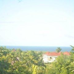 Отель Enchanted Villas and Guest House пляж