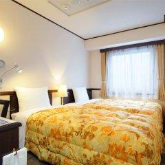 Отель Toyoko Inn Tokyo-eki Yaesu Kita-guchi комната для гостей фото 2