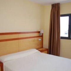Hotel Puerta Guadalajara комната для гостей