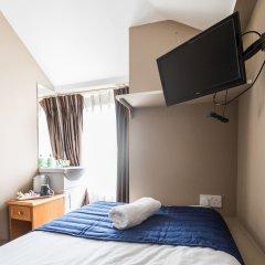 Oyo Belgravia Hotel сейф в номере