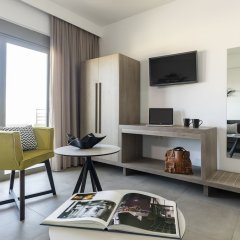 Апартаменты Mirage City Apartments Родос комната для гостей фото 4