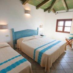 Отель Baia Chia - Chia Laguna Resort Италия, Домус-де-Мария - отзывы, цены и фото номеров - забронировать отель Baia Chia - Chia Laguna Resort онлайн комната для гостей