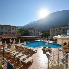 Belcehan Deluxe Hotel Турция, Олудениз - отзывы, цены и фото номеров - забронировать отель Belcehan Deluxe Hotel онлайн бассейн фото 3