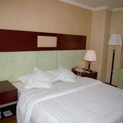 Отель CANAAN Сиань сейф в номере