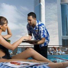Отель Crowne Plaza Dubai ОАЭ, Дубай - отзывы, цены и фото номеров - забронировать отель Crowne Plaza Dubai онлайн бассейн фото 2